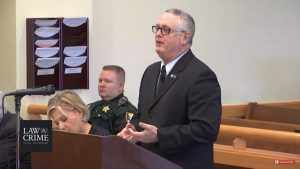 Jay Brizel '87 in a Florida courtroom in 2019 wearing his Augsburg pin