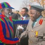 Man shakes hand of veteran