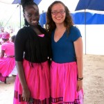 young women wear bright pink skirts and smile