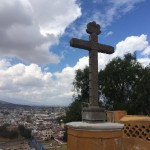 a large cross overlooking a city
