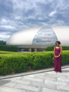 Woman stands in front of dome building