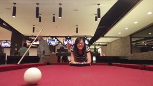 Student at a pool table