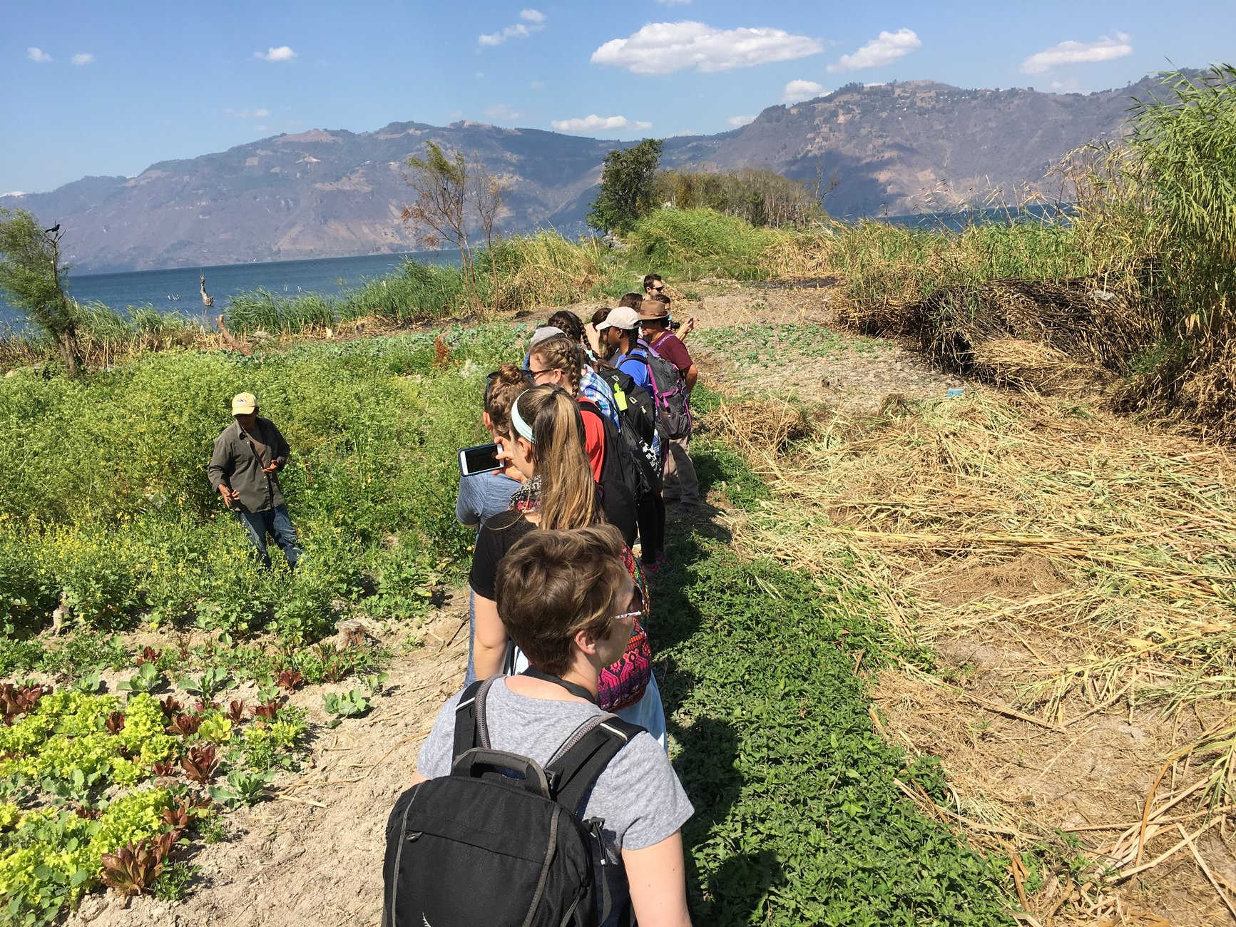 Students Hike with Mountains in background