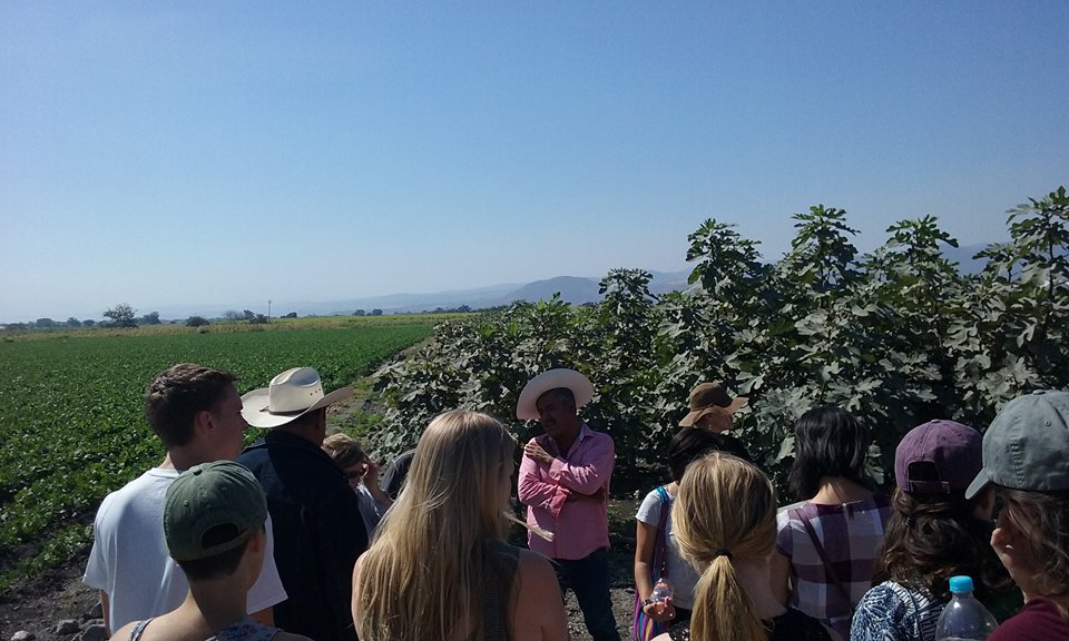 Students listen to a local farmer