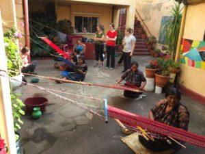 women weave hammocks in Guatemala