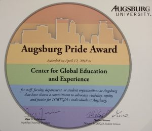 Pride Award for CGEE on rainbow paper