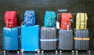 five rolling suitcases in a row