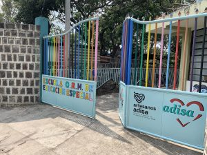 colorful gates open to a school