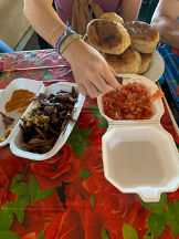 a table with two Styrofoam containers are half opened revealing a mixture of cooked beef
