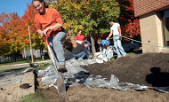 Student digging in community garden