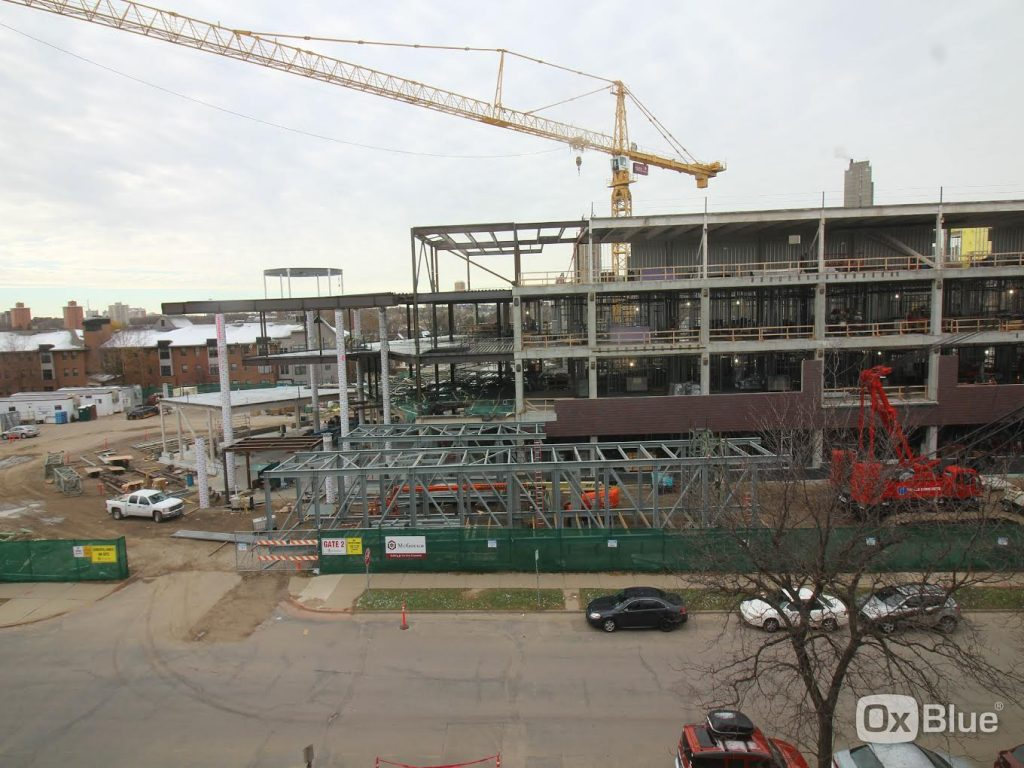 The Hagfors Center construction site Sunday, November 20, showing the structural steel framework for the skyway and the precast brick exterior installed on the east side of the building.