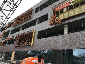 Construction crews continue installation of window frames on the east side of the north wing.