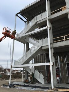 The structural steel installation of the west wing staircase is nearly complete.