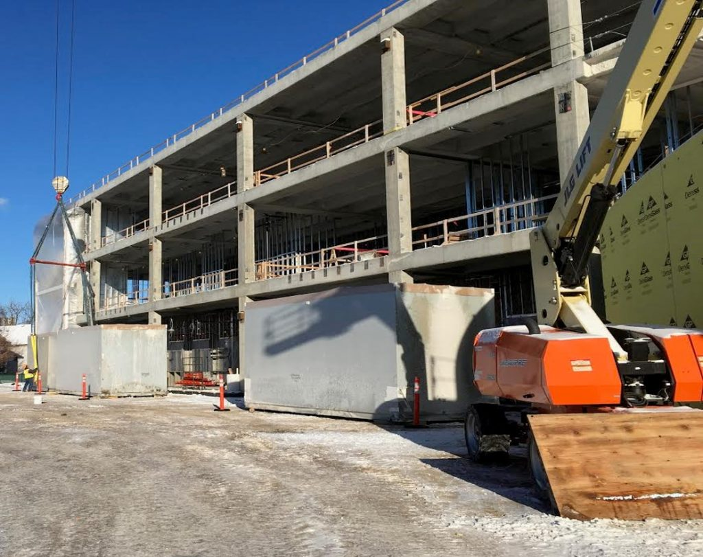 The building's two heating, ventilation and air-conditioning units were installed last week in the mechanical area on the fourth-level rooftop of the north wing.