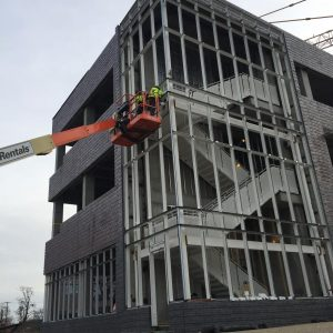 Crews prepare the steel structure on the west staircase to support installation of the glass curtainwall.