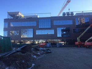 Glass installation is nearing completion on the west side of the north wing.