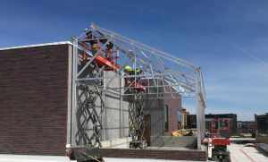 Crews install the structural aluminum framework for the rooftop greenhouse.
