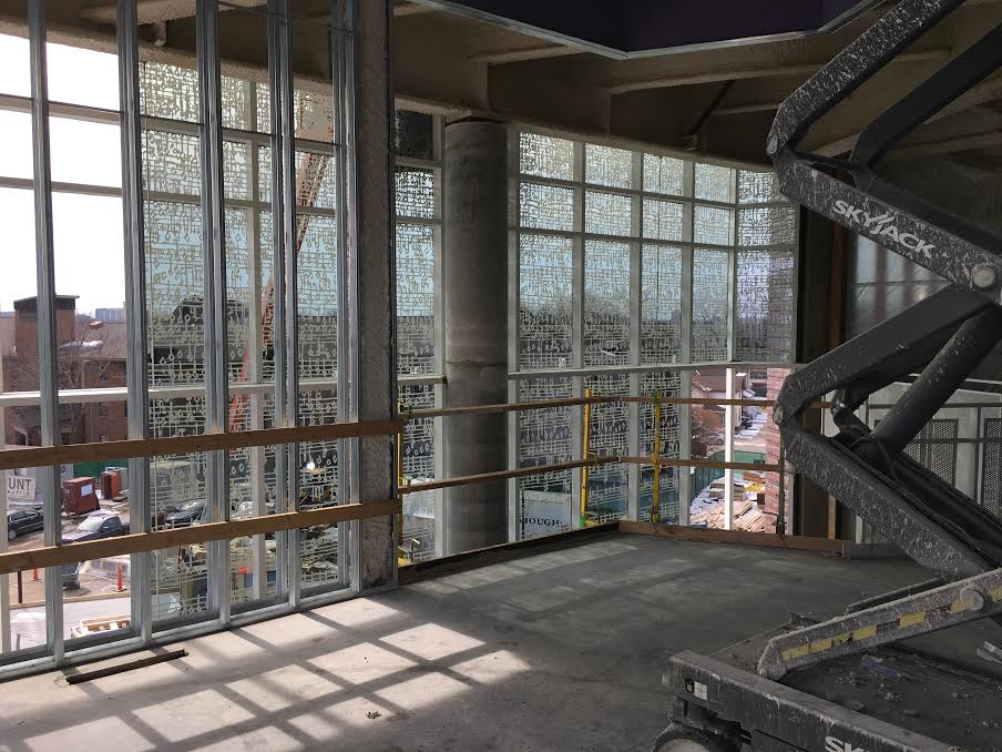 The installation of the window fritting on the 3-story lobby curtainwall is visible from the Gundale Chapel interior.