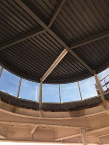 The signed beam is visible (for now) in the ceiling of the chapel. Glass installation on the cupola of the chapel is complete.