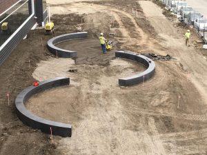 Exterior semi-circle concrete benches.
