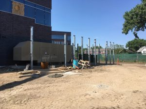 Posts for the electrical yard screenwall is in progress