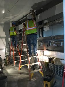Installation of environmental control equipment in the grow rooms.