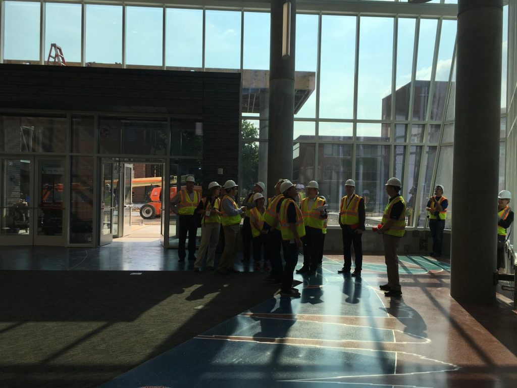 Members of the National Association of College and University Business Officers tour the Hagfors Center