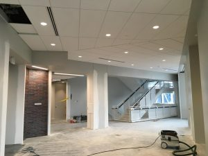 Ceiling and floor under construction in second-level lobby area