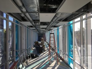Skyway with ceiling installation in progress.