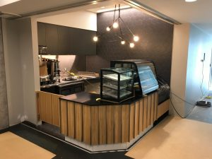 Corner coffee shop with counter and equipment
