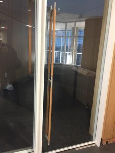 Glass door with wooden dowel handles