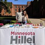 students at an outdoor Minnesota Hillel booth