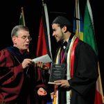 International student receives leadership award from Augsburg University President at Graduation Ceremony.