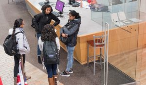 Four international students connecting on campus during international education week.