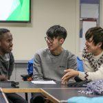 Students exchange ideas at International Student Orientation.