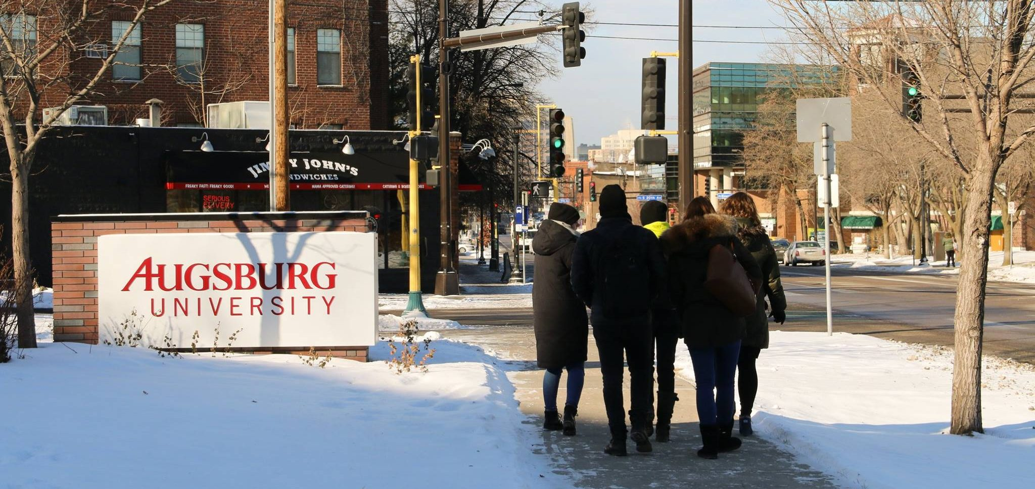 A group of new International students make their way off campus to explore during their first days at Augsburg University.