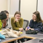 Four new students exchange ideas in the International Student Orientation.