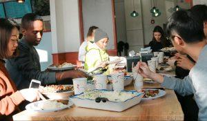 New international students enjoying lunch at Campus Cafe in Cedar Riverside.