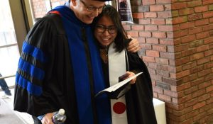 embrace before graduation ceremony