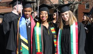 international students in graduation sashes
