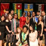 International students pose at banquet