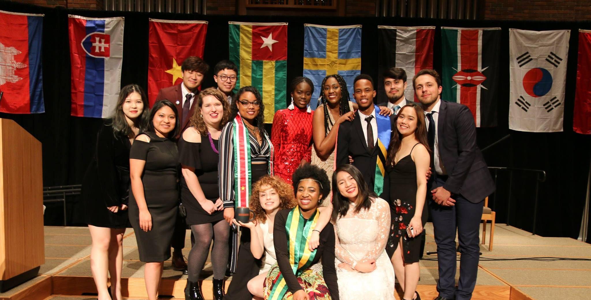 International students pose at banquet