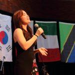 international student singing at banquet