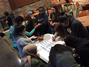 Students signing the group agreement they created.
