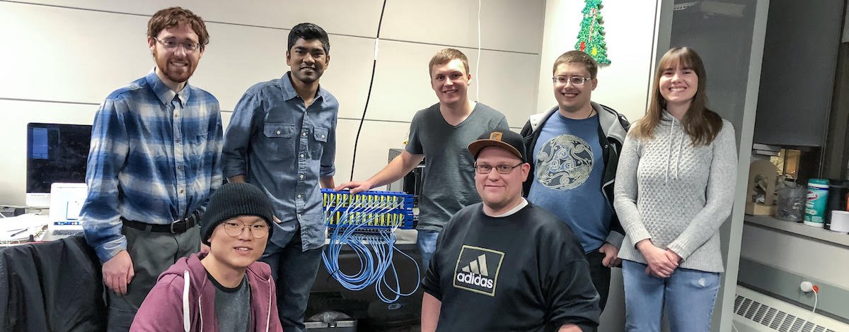 computer science students around a Raspberry Pi cluster