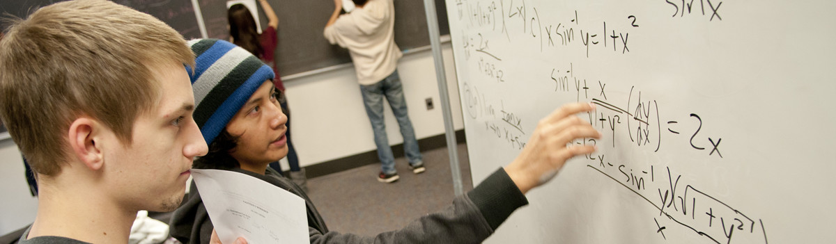 calculus students at white board