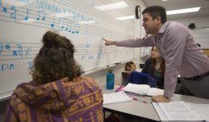 image of Reinaldo Moya teaching in the classroom