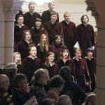 Augsburg Choir singing from the balcony, Advent Vespers 2019
