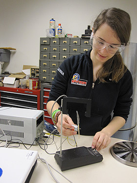 Taylor McCanna works in the Augsburg College labs. She developed six prototypes of a field mill before creating a device that could measure the global electric circuit.