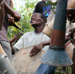 Haitian man plays a drum